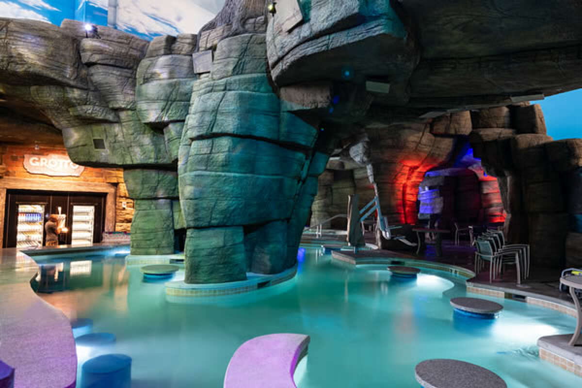 Guests 21 and over can enjoy beverages in the Grotto, a secluded, swim-up bar in the indoor waterpark, open only to adults.