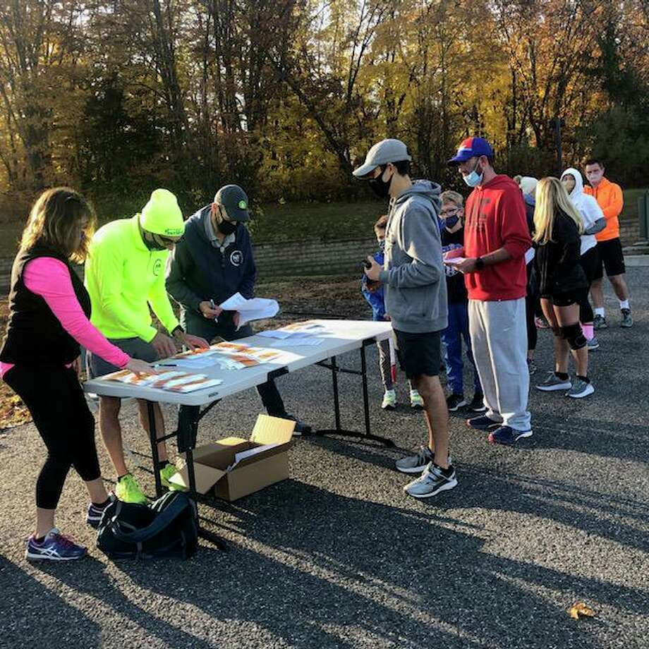 More than 150 runners from the region recently participated in New Milford Fitness and Aquatic Club's 5k and 10k races at Litchfield Crossings. Above, runners check in at the event. Photo: Courtesy Of Litchfield Crossings / Danbury News Times Contributed