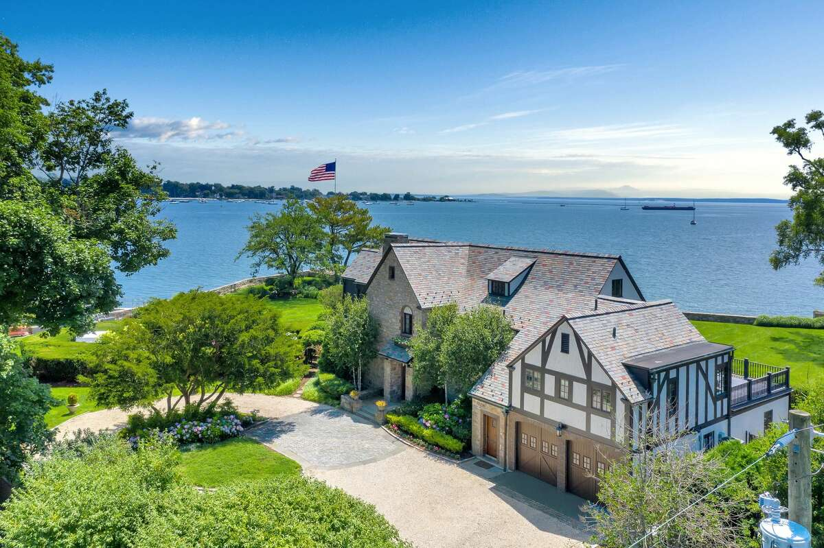Waterfront home located at 236 Davenport Drive in Stamford, Connecticut.  The home at 236 Davenport Drive was not on the market for long. It was listed in July for $5.75 million and went into contract in August until a deal was struck at the end of October, according to the Senior Vice President of Communications at Browns Harris -- which recently merged with Halstead-- Ashley Murphy.