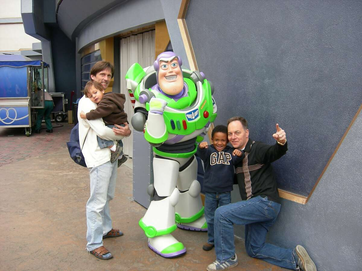 The Fisher-Paulson family pose with Buzz Lightyear at Disneyland in Anaheim, California, on January 4, 2008.
