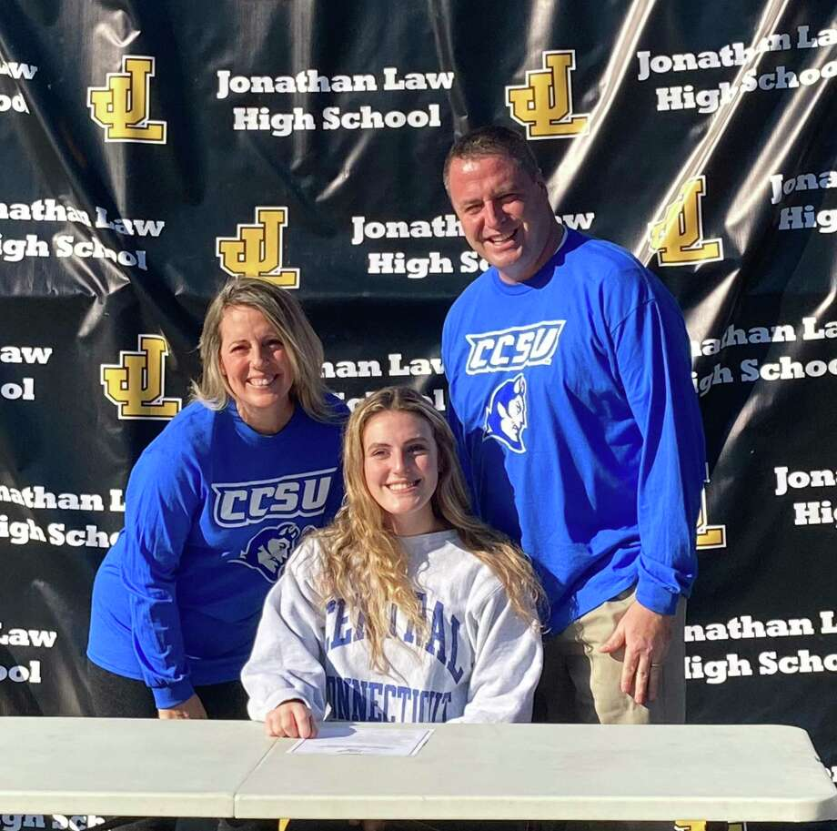 Law volleyball standout Alexis Neider is joined my parents John and Kelly when she signed to play for Central Connecticut State University in the Division I Northeast Conference. Photo: Law Athletics / Contributed Photo / Milford Mirror