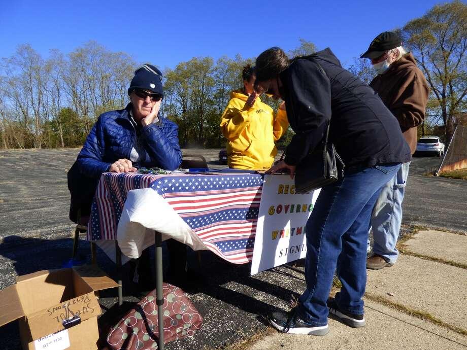 Volunteers gather signatures to recall Gov. Gretchen Whitmer on Nov. 3, 2020. Photo: Scott Fraley
