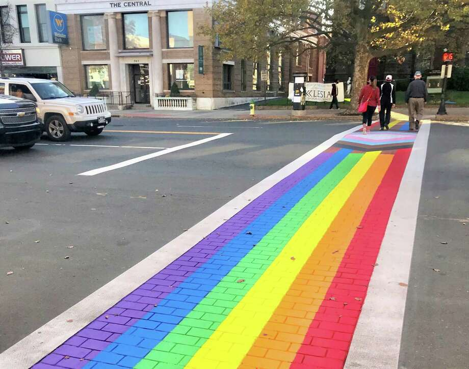 Middletown recently commissioned artist Brian Colbath to repaint the crosswalk in front of Main Street Market, at 386 Main St., in LGBTQIA colors as part of Middletown Pride's year-round observance. Colbath is also creator of the Gay Pride Month rainbow flag at West Hartford's Blue Back Square located near the West Hartford Public Library. Photo: Cassandra Day / Hearst Connecticut Media