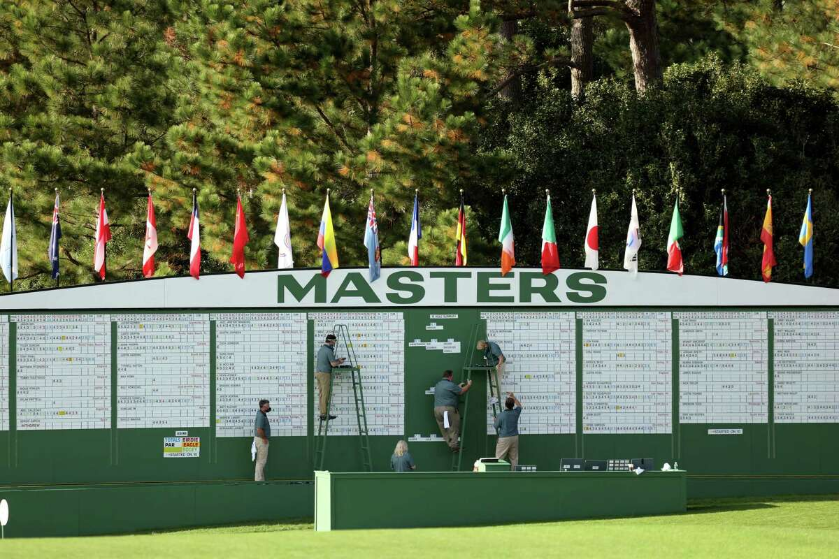 AUGUSTA, GEORGIA - NOVEMBER 12: The scoreboard is updated during the first round of the Masters at Augusta National Golf Club on November 12, 2020 in Augusta, Georgia.