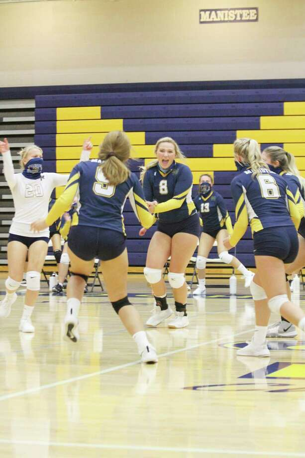 Manistee senior Logan Wayward (center) celebrates a point with teammates earlier this season. Wayward was named to the Lakes 8 Conference second team for her play this season. (News Advocate file photo)