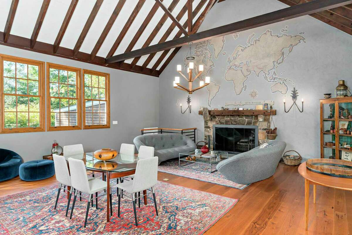 """""""Be welcomed by the two-story great room offering stunning beams, walls of windows, oversized stone fireplace along with iconic painted overmantel map of the world by former owner and renowned artist Hildreth Meiere,"""" said listing agent Denise Doonan of William Ravies Real Estate. Mejere bought the home in 1944 and paid just $17,500 for it. The property became a weekend, summer property for Mejere and her daughter Louise."""