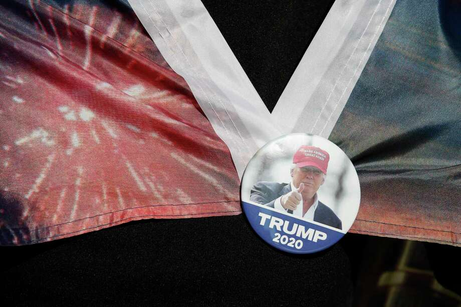 A woman wears a Trump button as supporters of President Donald Trump protest outside the Pennsylvania Convention Center, where vote counting continues, in Philadelphia, Nov. 9, two days after the 2020 election was called for Democrat Joe Biden. Photo: Rebecca Blackwell / Associated Press / Copyright 2020 The Associated Press. All rights reserved.