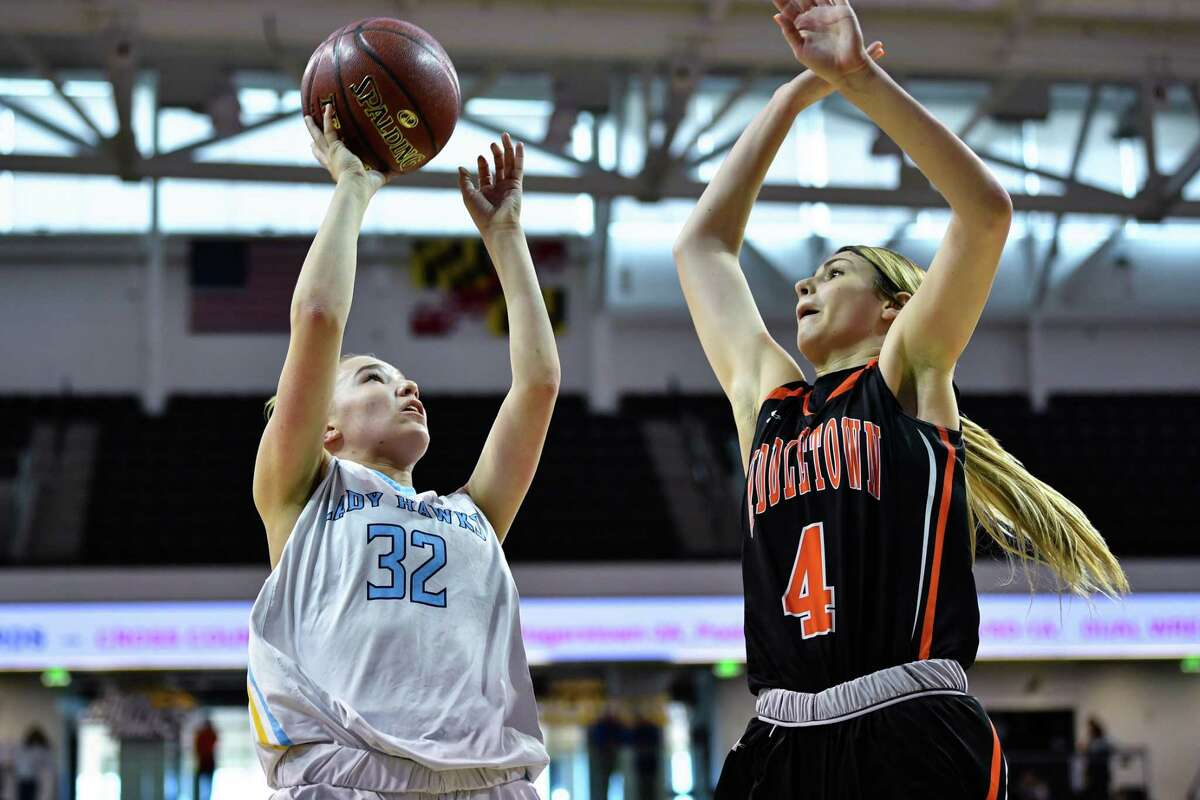 TOWSON, MD - MARCH 16: River Hill Hawks guard Erin Devine (32) attempts shot over Middletown Knights guard Saylor Poffenbarger (4) during the third quarter at SECU Arena. (Photo by Terrance Williams for The Washington Post via Getty Images)
