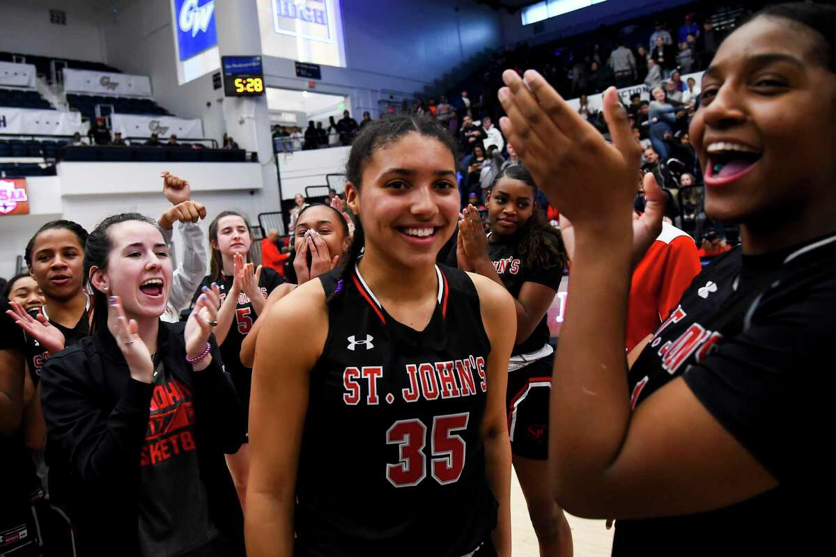 WASHINGTON, DC - MARCH 1: Azzi Fudd #35 of St. John's reacts after receiving the MVP award after defeating Sidwell Friends for the DCSAA Class AA Basketball Finals at George Washington University in Washington, DC on March 1, 2020. (Photo by Will Newton for The Washington Post via Getty Images)