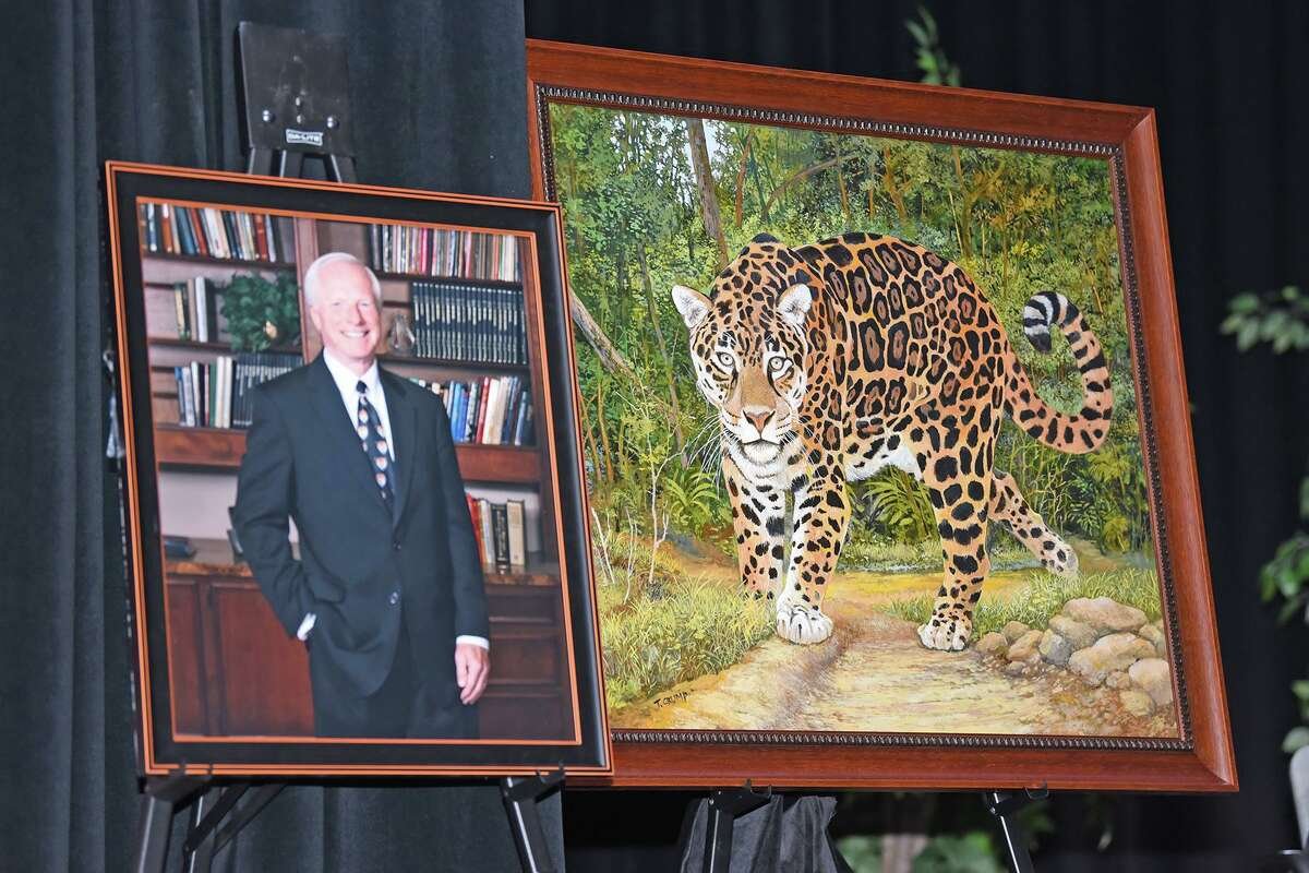 Harold Rowe's official portrait, right, stands next to a custom painted picture of a jaguar, which Rowe and his wife Sandy gifted to Rowe Middle School in honor of the school's mascot during a dedication ceremony on Nov. 8.