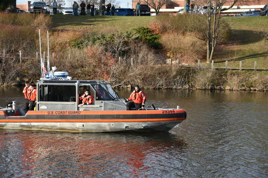 First responders from a list of departments such as the Manistee County Sheriff's Office as well as a dive team and the U.S. Coast Guard could be seen along the Manistee River channel and downtown Manistee Thursday afternoon. Photo: Arielle Breen/News Advocate