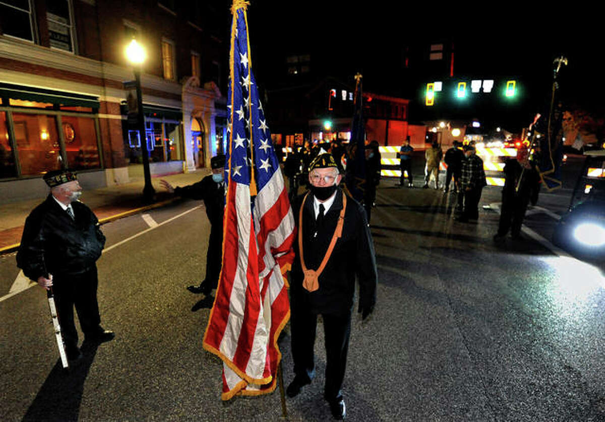 Senior Vice Commander American Legion Post 199 Ron Swaim (front) lines up with other marches for the Veteran's Day parade Wednesday evening.