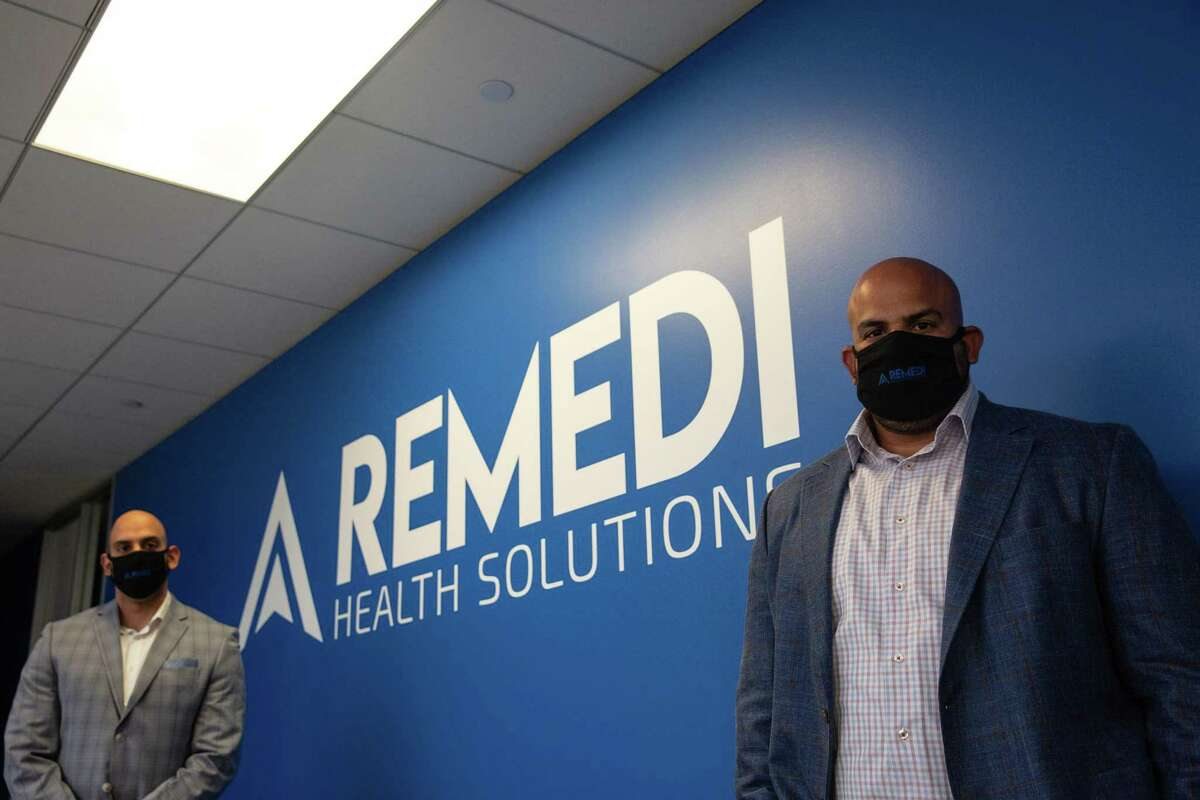 Sonny Hyare, right, CEO of ReMedi Health Solutions, and managing director GP Hyare, left, pose for a portrait at their office on Nov. 6, 2020.