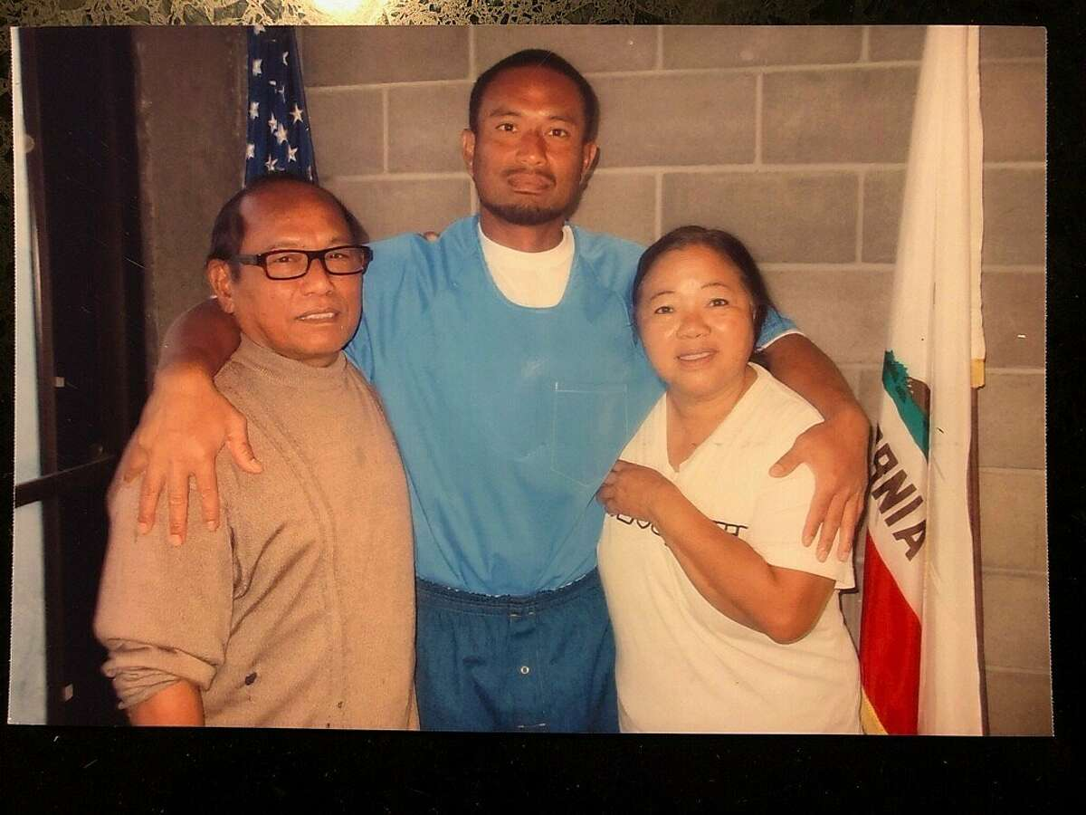 Bounchan Keola, shown with his parents, is facing deportation to Laos, a country he left at age 2.