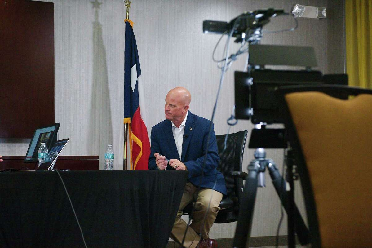 Pearland mayor-elect Kevin Cole listens as moderator Felicia Harris Hoss asks a question during Cole's town hall meeting on Nov. 11, which was streamed live on Facebook.