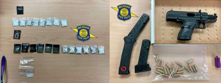 Evidence seized in a traffic stop in Inland Township leading two three arrests and charges included suspected drugs and a 9mm handgun. (Courtesy Photo)