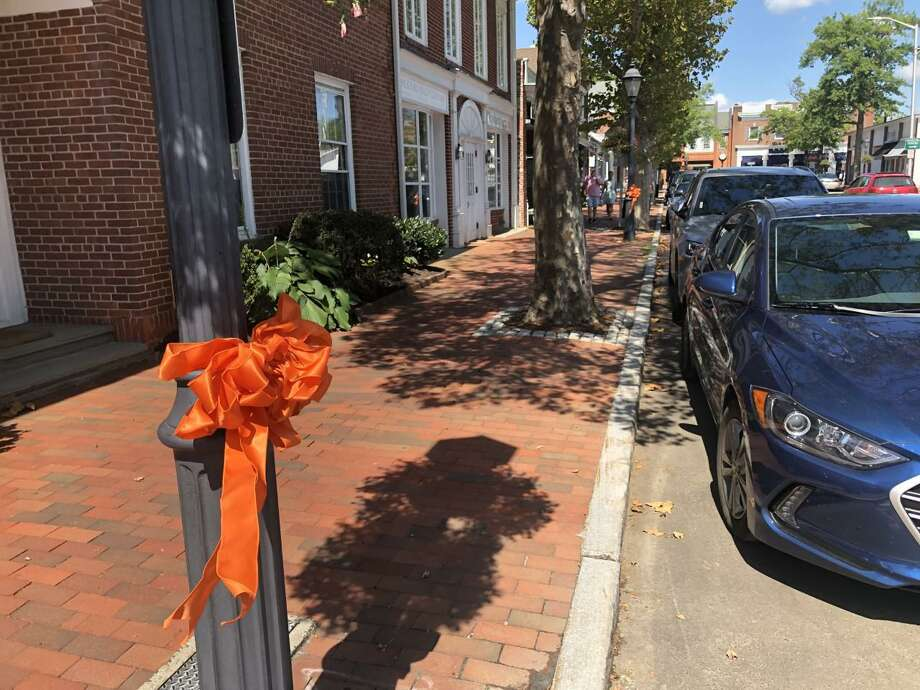 Orange ribbons adorn throughout the Town of New Canaan, Connecticut prior to a previous Community Overdose Awareness Vigil at South Avenue and Elm Street in the town. The New Canaan Parent Support Group is re-starting its Monthly Pathway Series Nov. 18 at 7 p.m. via the Zoom application. Photo: Contributed Photo