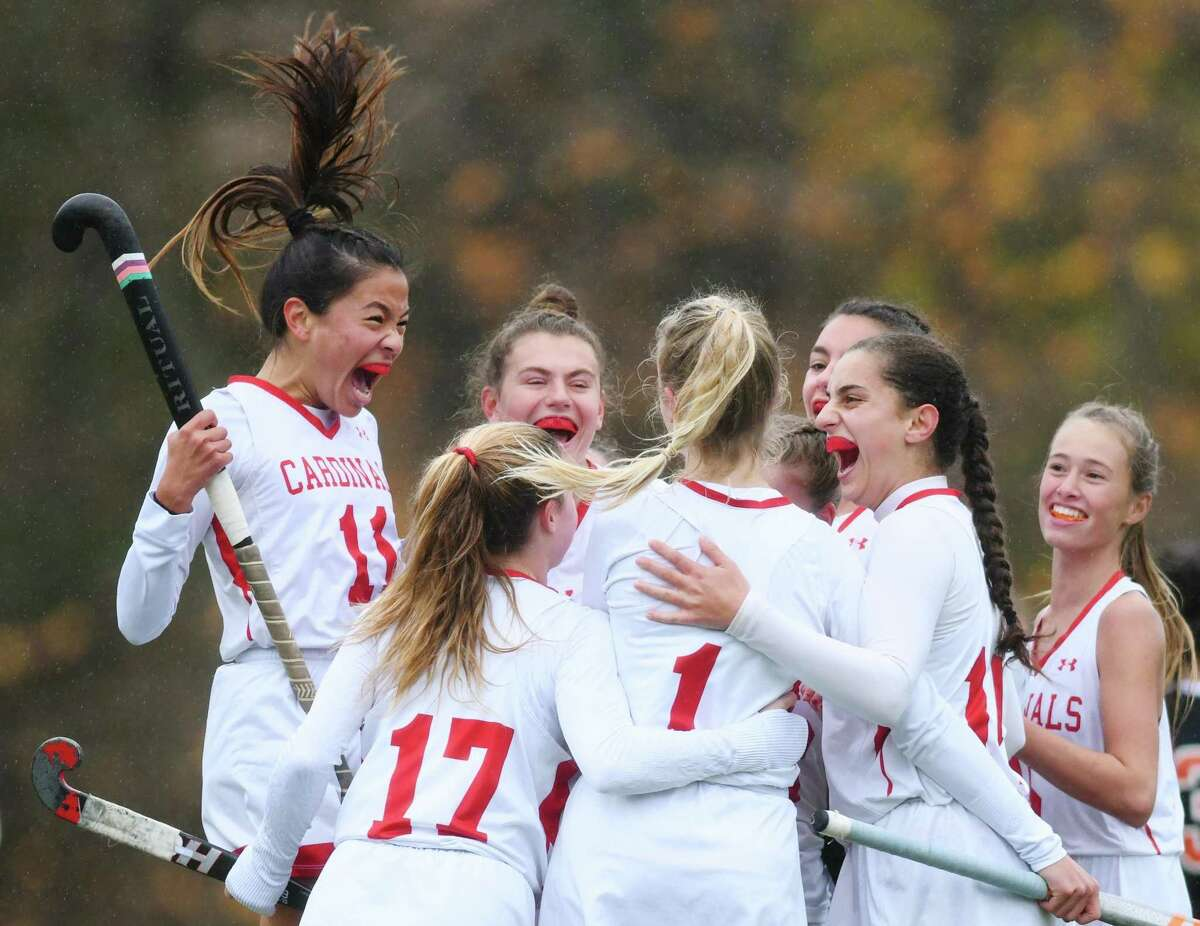 Greenwich's Eleanor Ybarra (11) and others celebrate Zita Cohen's (1) goal in Greenwich's 6-0 win over Stamford in the FCIAC West championship game at Greenwich High School in Greenwich, Conn. Thursday, Nov. 12, 2020.