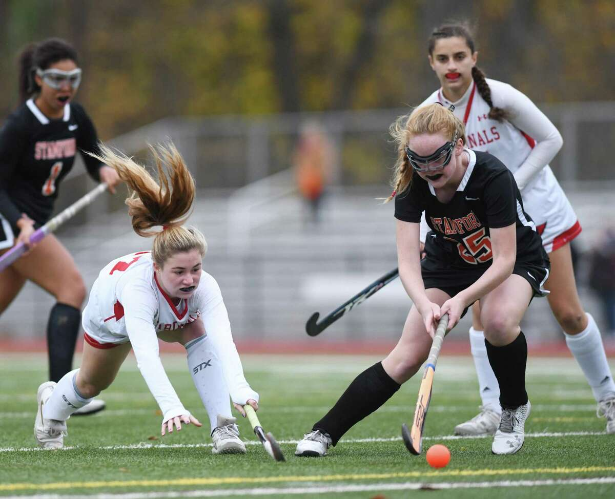 Greenwich's Kayla Johnson, left, and Stamford's Caroline Fay battle for the ball in Greenwich's 6-0 win over Stamford in the FCIAC West championship game at Greenwich High School in Greenwich, Conn. Thursday, Nov. 12, 2020.