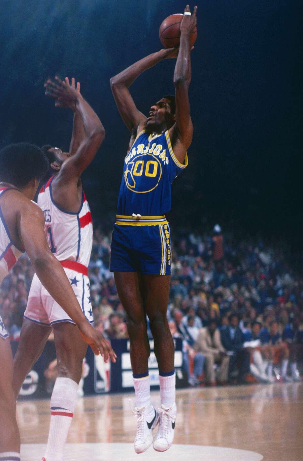 FILE: Golden State Warriors center Robert Parish makes a jumpshot against the Washington Bullets at Capital Center circa 1978 in Washington, D.C.