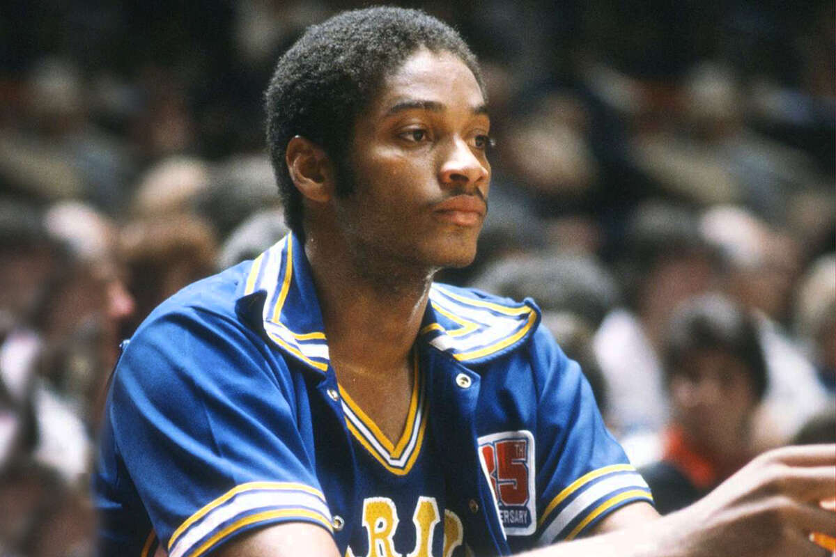 FILE: Joe Barry Carroll of the Golden State Warriors looks on from the bench against the New York Knicks during an NBA basketball game circa 1980 at Madison Square Garden in the Manhattan borough of New York City. Carroll played for the Warriors from 1980-83 and 1985-87.