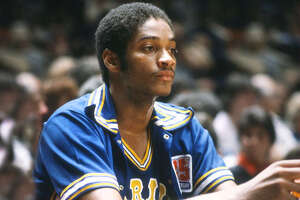 Joe Barry Carroll #2 of the Golden State Warriors looks on from the bench against the New York Knicks during an NBA basketball game circa 1980 at Madison Square Garden in the Manhattan borough of New York City. Carroll played for the Warriors from 1980-83 and 1985-87. (Photo by Focus on Sport/Getty Images)