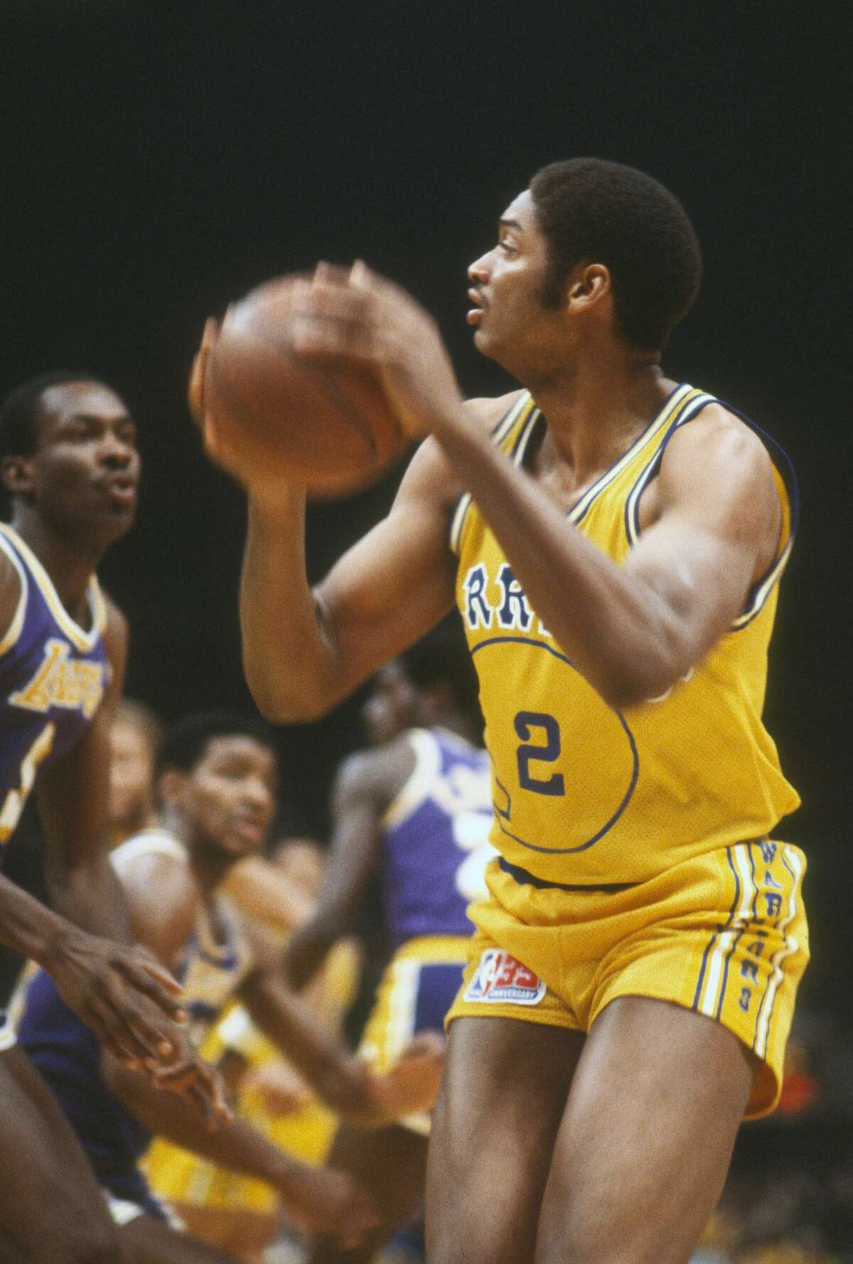 FILE: Joe Barry Carroll #2 of the Golden State Warriors looks to shoot against the Los Angeles Lakers during an NBA basketball game circa 1980 at the Oakland-Alameda County Coliseum.