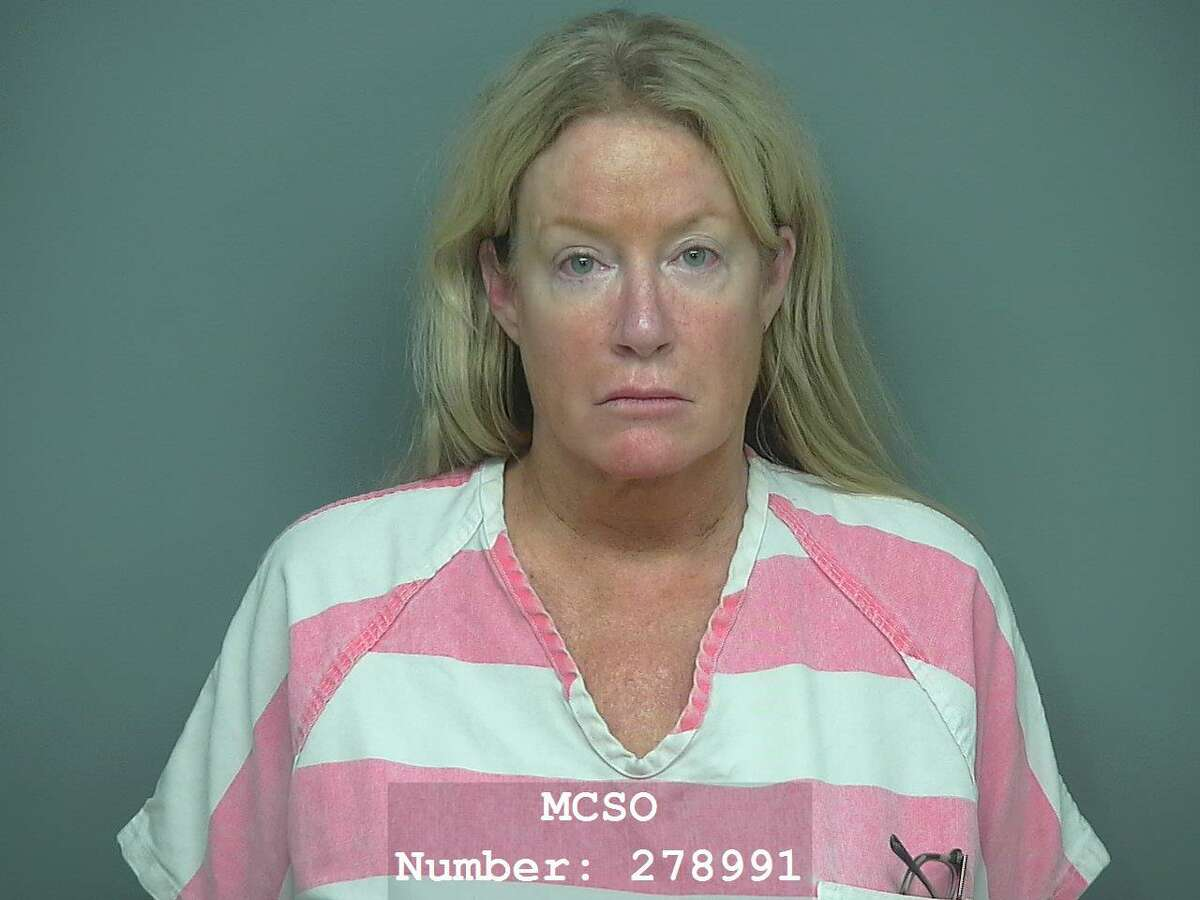 Barbara Ann Kenney, 56, of The Woodlands, is being charged with tampering with evidence of a human corpse, a second-degree felony.