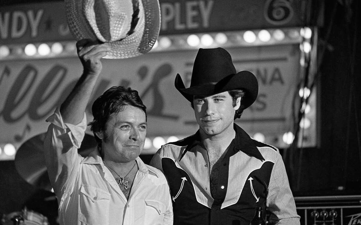 06/05/1980 - Mickey Gilley and John Travolta at Houston movie premiere party for