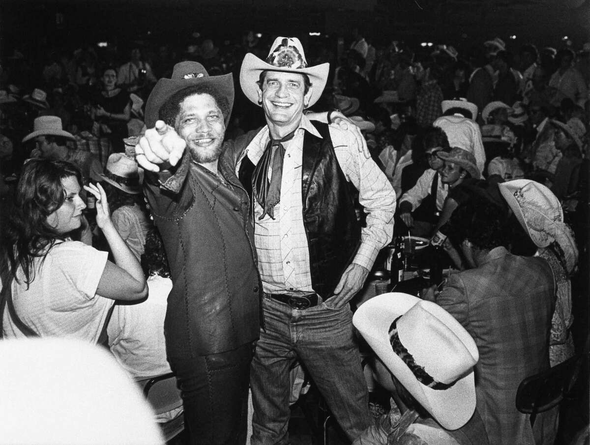 """06/05/1980 - (L-R) U.S. Reps Mickey Leland of Houston and Charlie Wilson of Lufkin at the Houston movie premiere party for """"Urban Cowboy"""" at Gilley's club."""