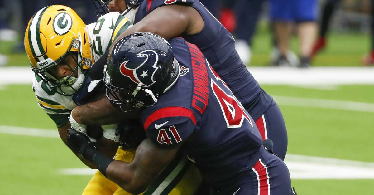 Houston Texans defensive end Carlos Watkins (91) and inside linebacker Zach Cunningham (41) stop Green Bay Packers running back A.J. Dillon (28) at the line of scrimmages during the first half of an NFL football game at NRG Stadium on Sunday, Oct. 25, 2020, in Houston.