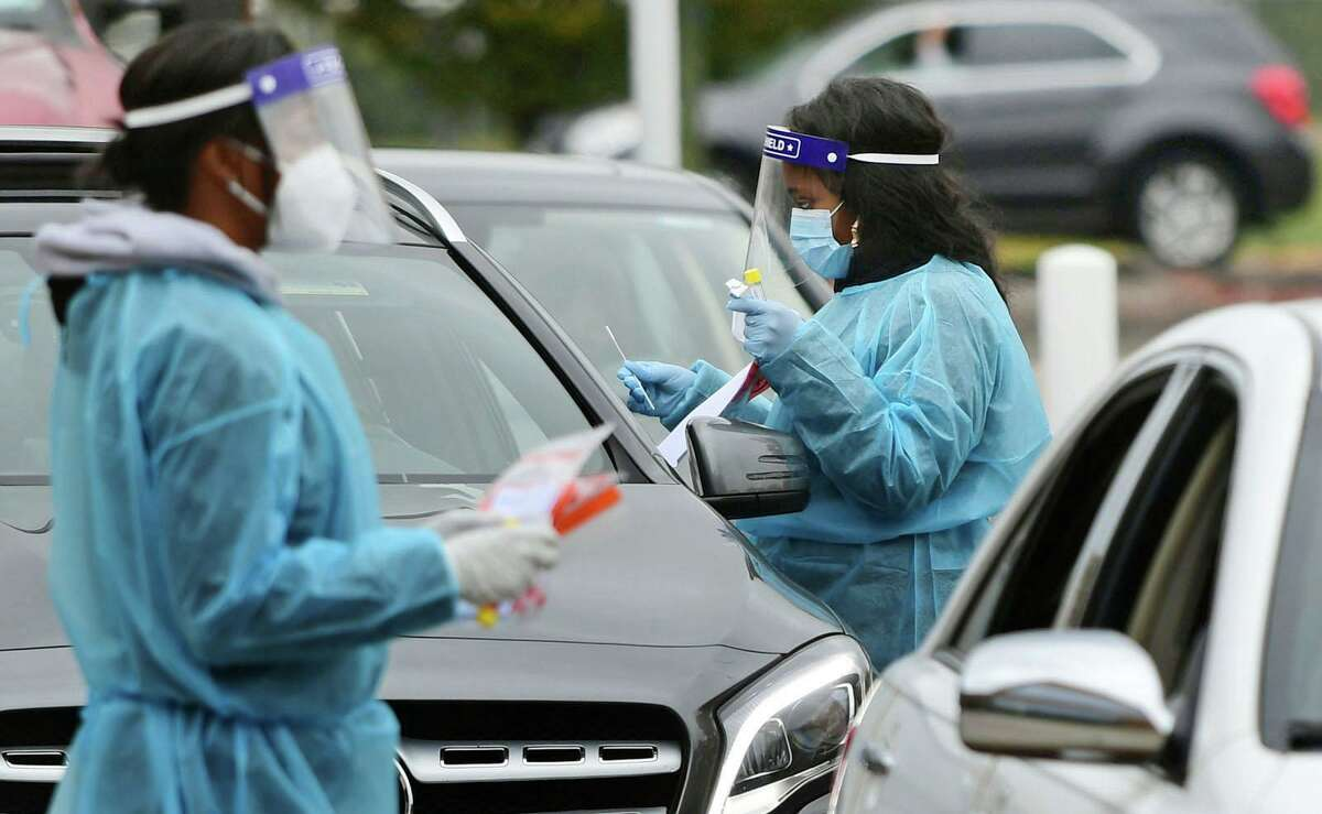 Day Street Community Health Center staff conduct drive-thru coronavirus testing on Oct. 28 in Norwalk.