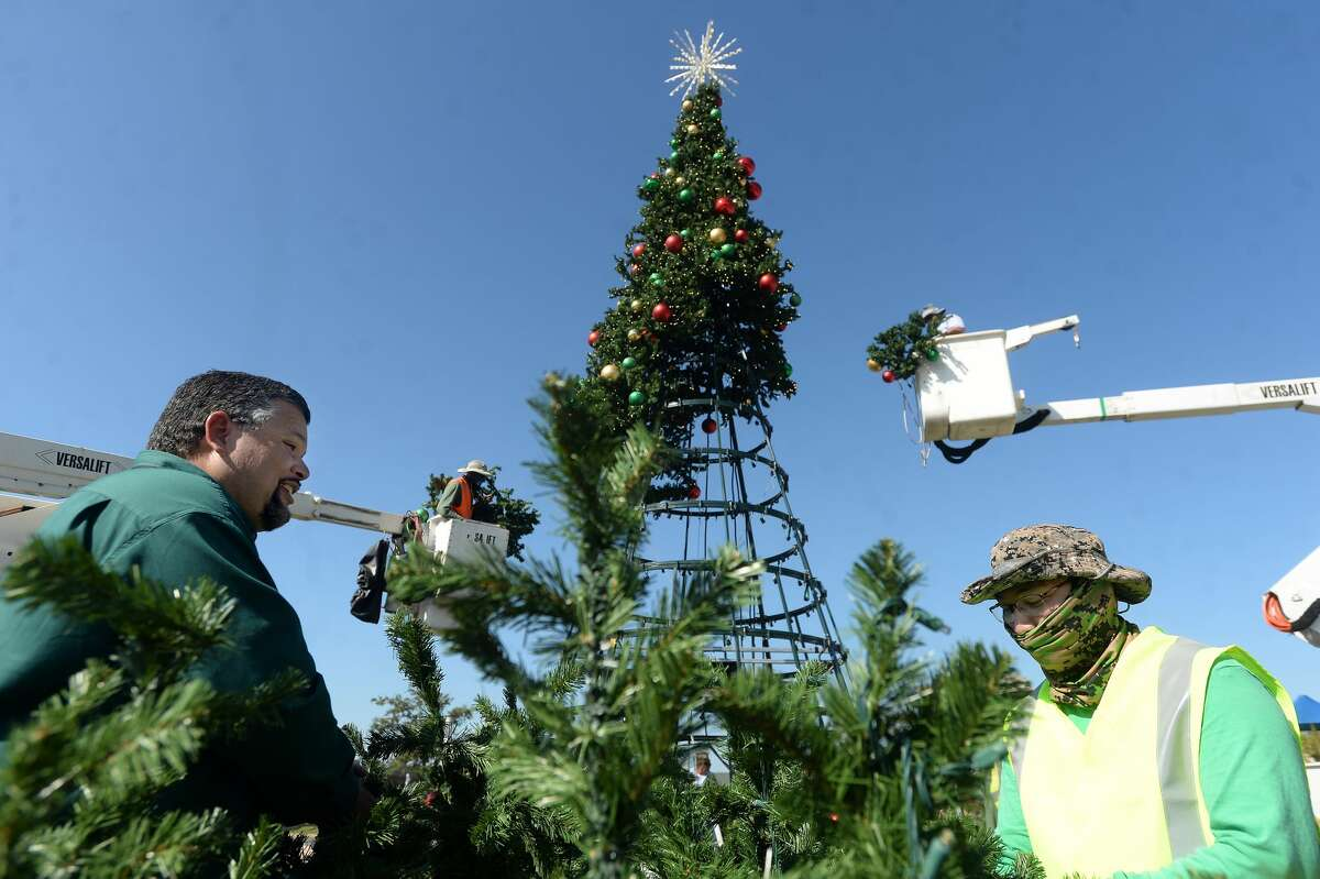 Workers with the City of Beaumont worked throughout the day Thursday to erect the Christmas tree outside the Event Centre. Photo taken Thursday, November 12, 2020 Kim Brent/The Enterprise
