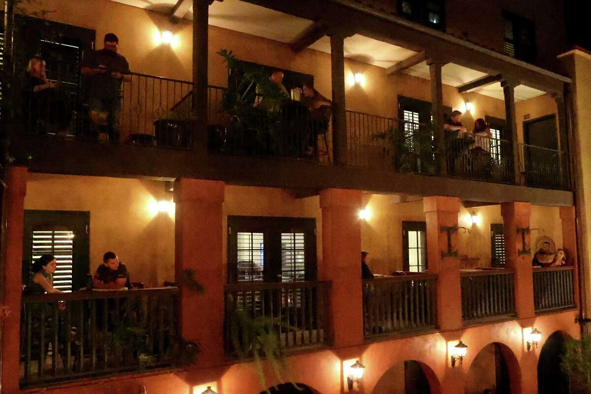 Guests at the Hotel Valencia Riverwalk are able to enjoy a weekend Tengo performance by Luisa Vasquez and Julio Ossorio Torres in the courtyard from their balconies on Saturday, Oct. 17, 2020.