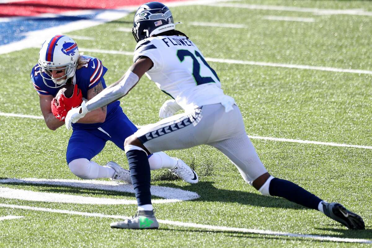 ORCHARD PARK, NEW YORK - NOVEMBER 08: Cole Beasley #11 of the Buffalo Bills catches a pass as Tre Flowers #21 of the Seattle Seahawks attempts to tackle him during the first quarter at Bills Stadium on November 08, 2020 in Orchard Park, New York. (Photo by Bryan Bennett/Getty Images)