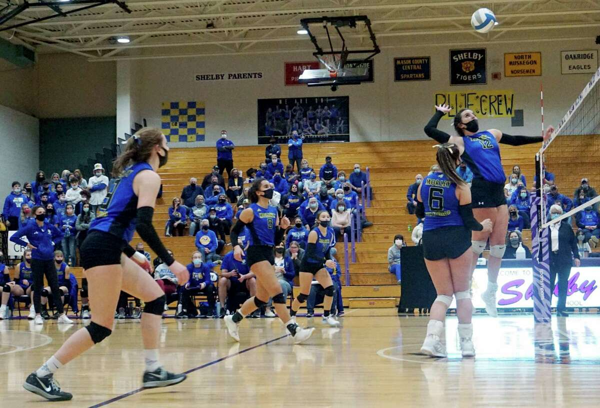 Morley Stanwood's Brooke Brauher rises to hit the ball back over the net during the Mohawks loss in four sets to Grandville Calvin Christian in the Region 19 Championship match on Thursday night in Shelby. (Pioneer photo/Joe Judd)