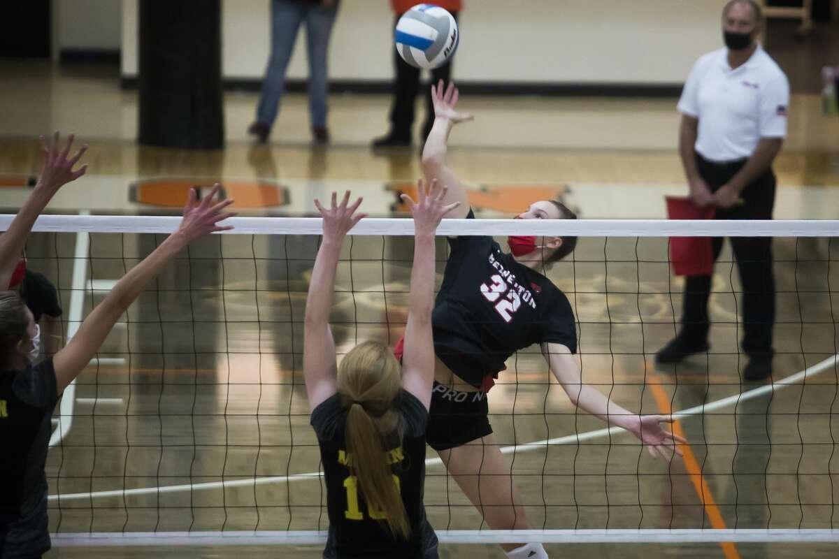 Beaverton's Molly Gerow spikes the ball during the Beavers' regional final victory over McBain Thursday, Nov. 12, 2020 at Manton High School in Manton. (Katy Kildee/kkildee@mdn.net)