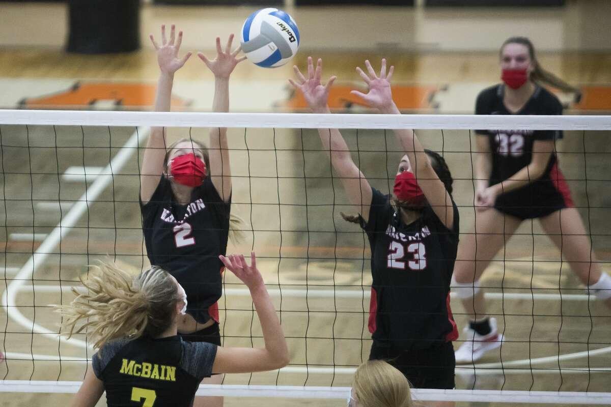Beaverton's Becca Wirt and Hannah Stearns jump up to block the ball during the Beavers' regional final victory over McBain Thursday, Nov. 12, 2020 at Manton High School in Manton. (Katy Kildee/kkildee@mdn.net)