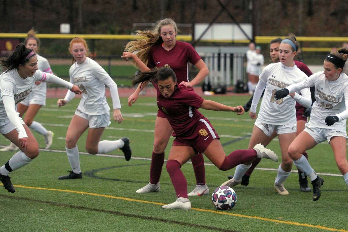 St. Joseph's Andriana Cabral takes a shot on goal during high school soccer action against Trumbull at St. Joseph High School, in Trumbull, Conn. Nov. 12, 2020.