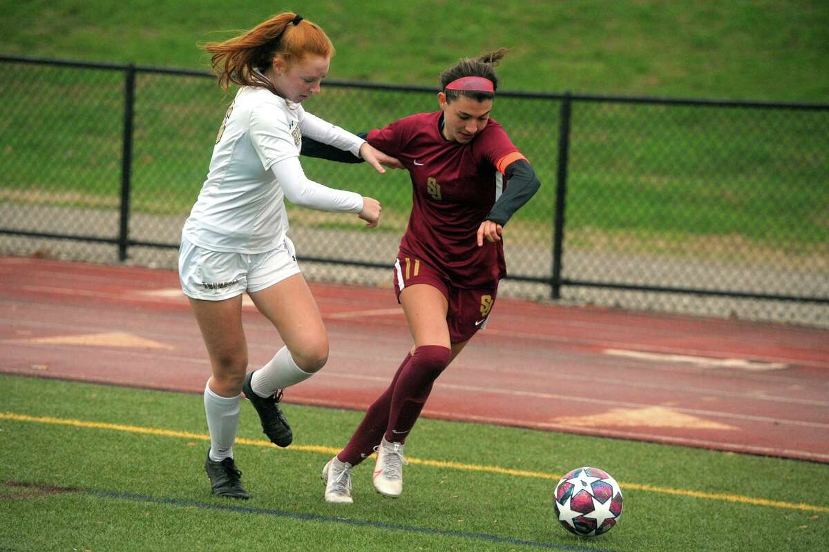 St. Joseph's Maddie Fried, right, competes with Trumbull's Elizabeth Foley during high school soccer action at St. Joseph High School, in Trumbull, Conn. Nov. 12, 2020.