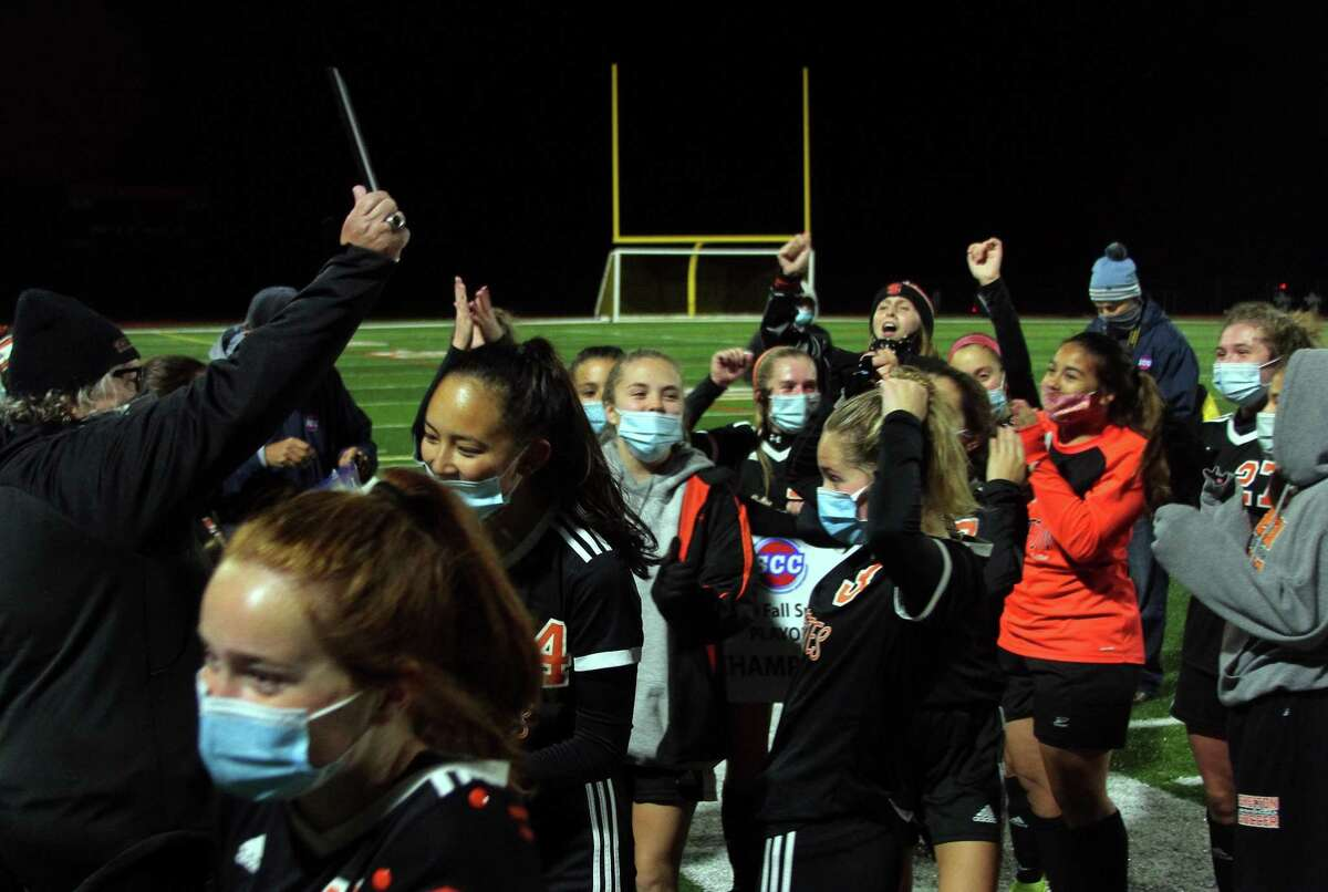 Shelton celebrates its win over Foran in SCC girls soccer playoff action in Shelton, Conn., on Thursday Nov. 12, 2020.