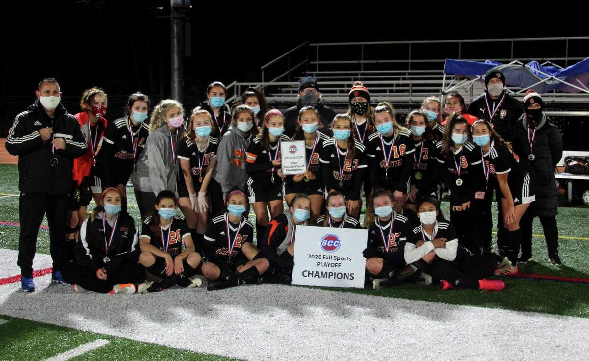 Shelton poses for a group photo after its win over Foran in SCC girls soccer playoff action in Shelton, Conn., on Thursday Nov. 12, 2020.