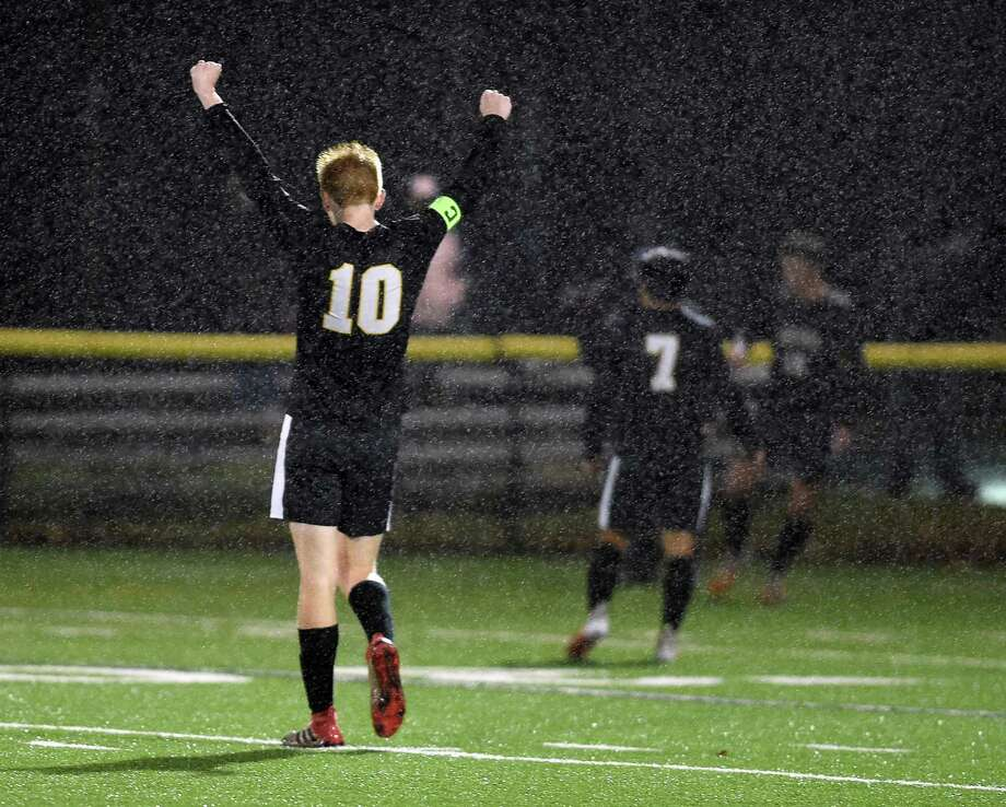 Hand's Scott Testori celebrates in the final seconds of the Tigers' 3-1 victory over Guilford in the SCC Championship in Madison last week. Photo: Arnold Gold / Hearst Connecticut Media / New Haven Register
