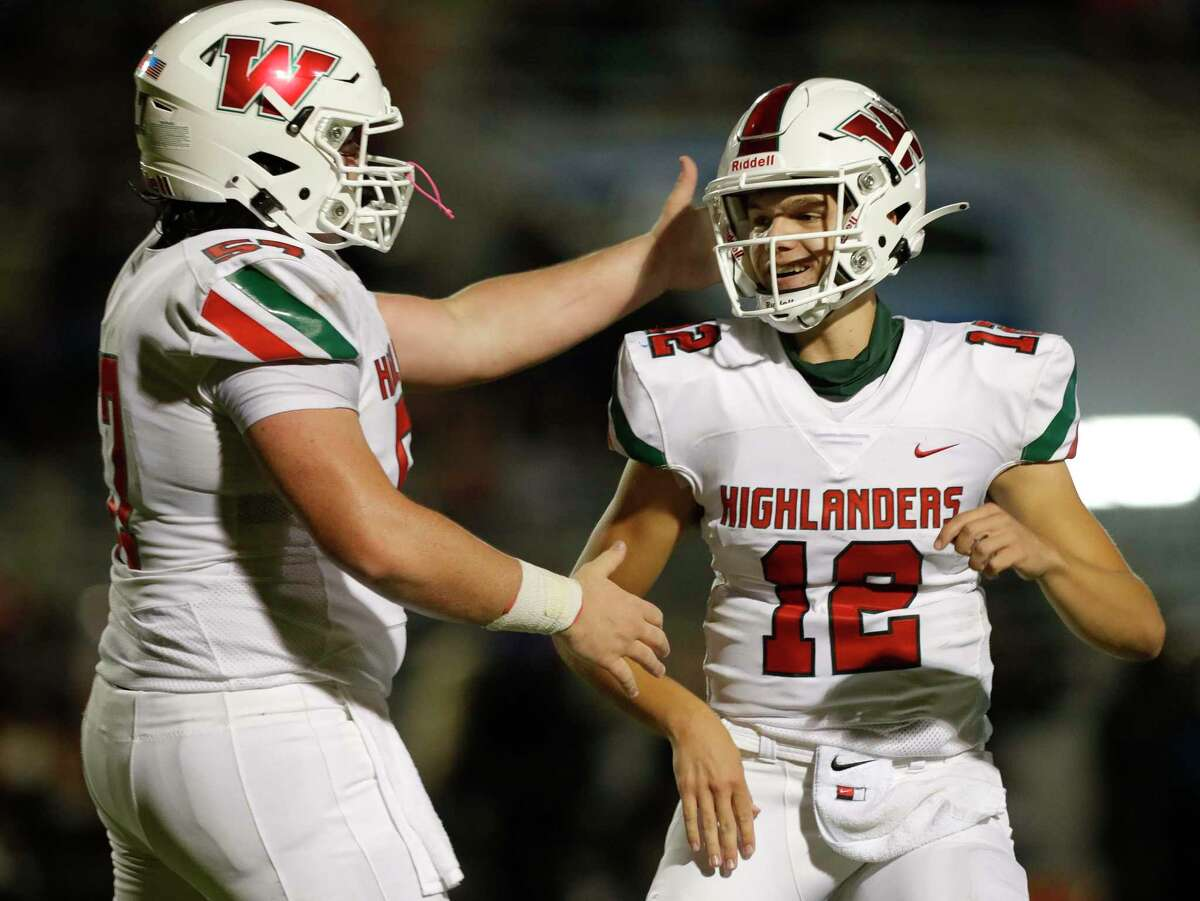 The Woodlands quarterback Connor Dechiro (12) reacts toward offensive linemen Titan Tucker (57) after running for a 3-yard touchdown during the third quarter of a District 13-6A high school football game at Woodforest Bank Stadium, Thursday, Nov. 12, 2020, in Shenandoah.