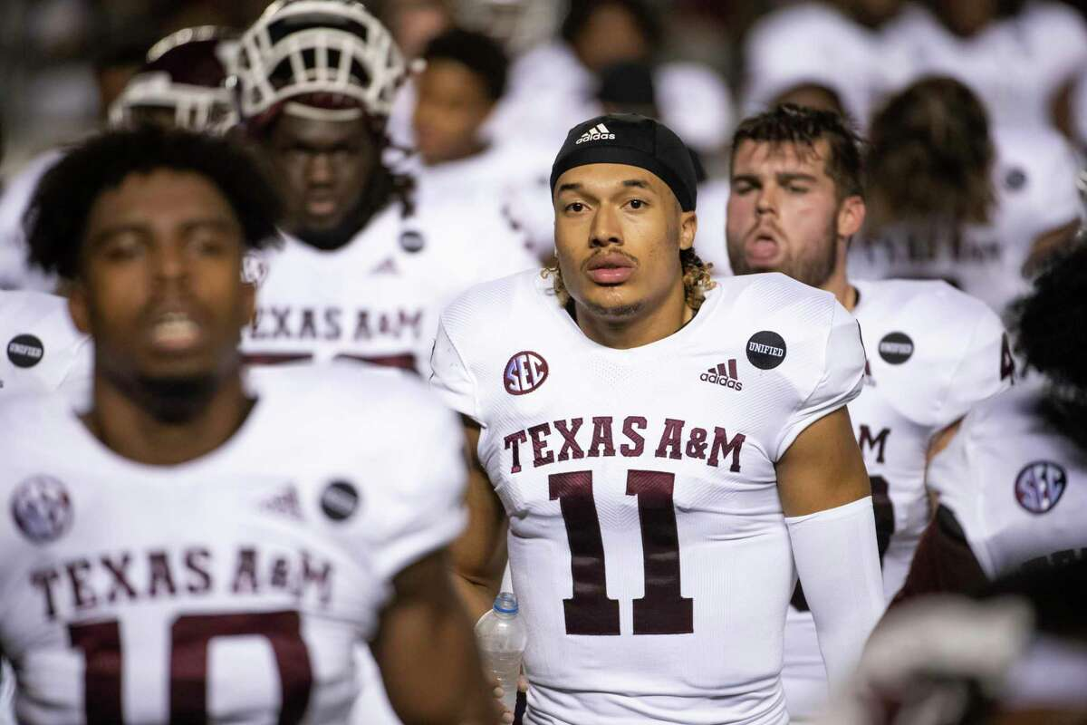 Because of three positive COVID tests and the resultant contact tracing, Texas A&M and quarterback Kellen Mond (11) have had two November games postponed and can't even practice until Sunday.