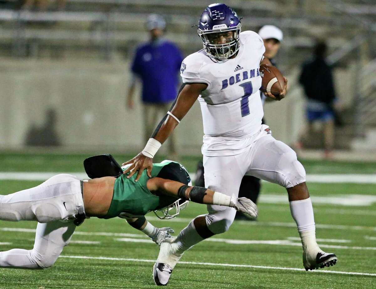 Greyhound quarterback Rashawn Galloway moves to the outside left in the first half as Boerne plays Burnet in Class 4A football playoff action at Reeves Stadium in Round Rock on Nov. 12, 2020.