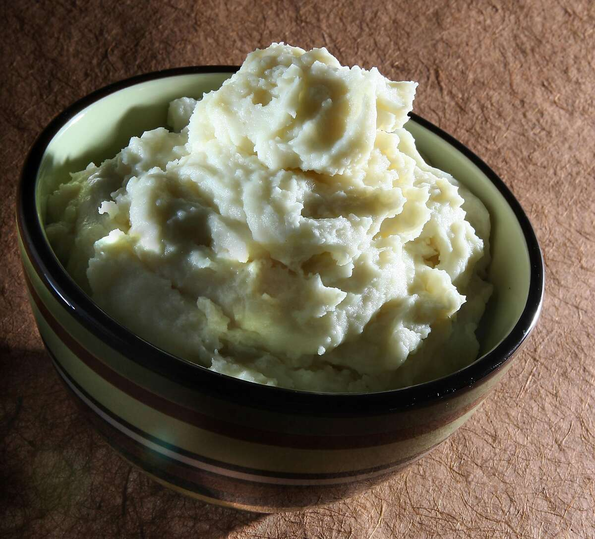 #1 Mashed Potatoes  Whether they're served plain with butter and milk or mixed with a little cream cheese and sprinkled with bacon bits, mashed potatoes are at the top of my list - and the first side to run out in many households.
