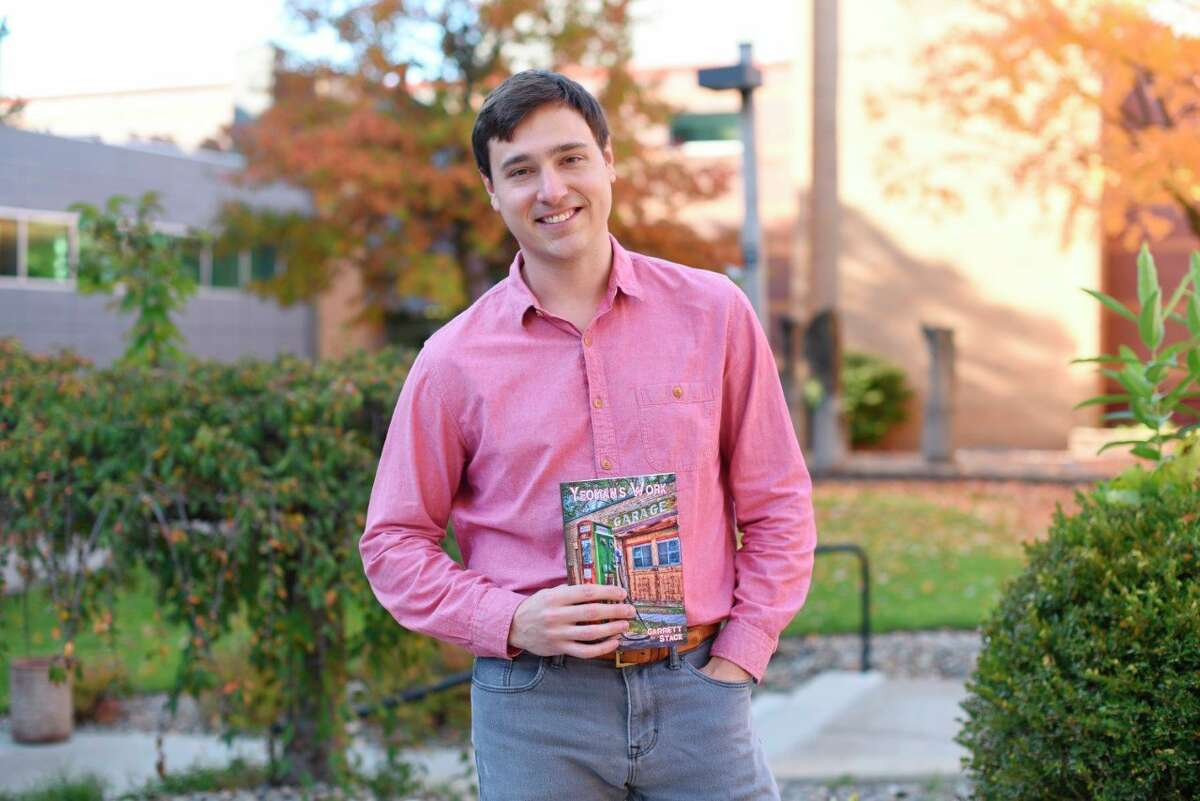 """Assistant Professor at Ferris State University Garrett Stack recently published a collection of poetry. The collection is called """"Yeoman's Work,"""" andhas been published through Bottom Dog Press. (Courtesy photo)"""