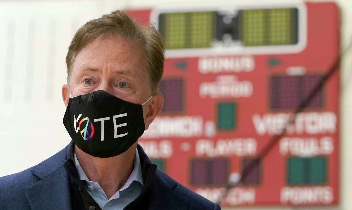 Connecticut Gov. Ned Lamont prepares to cast his vote at Greenwich High School Nov. 3, 2020.