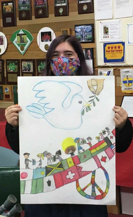 "Each year Lions Clubs International sponsors a Peace Poster contest for youth ages 11 to 13. In spite of the pandemic, Coleman Community Schools art teacher Lane Dexter was again willing to offer his students the opportunity to participate in Coleman Lions Club's local contest. The 2020 theme is ""Peace Through Service."" On Nov. 2, Coleman seventh grader Charisma Gingrich was awarded a certificate and check as this year's local winner. Her poster has been forwarded on to the district level contest (43 clubs). If Charisma's poster wins at that level, it will then be in the Lions of Michigan contest. We wish her good luck and thank her for participating. (Photo Provided)"